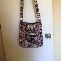 Messenger style purse This pattern matches the netbook case listed. It has been used, so the whit parts are not pristine white. Super long strap & very roomy inside. Vera Bradley Bags Crossbody Bags