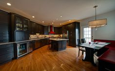 That bright red range and hood are the perfect eye-candy...   Synergy D&C, Reston, VA