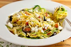 A quick, healthy dinner recipe. Greek Zucchini Noodles (Zoodles) with Feta, Olives, Artichokes and Tomatoes.