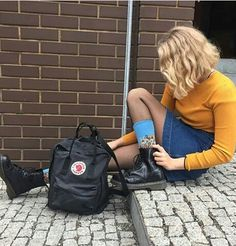 ✧ •yellow shirt, jean skirt, doc martens, black back pack, blue socks with flower pattern • ✧