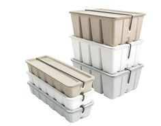 Midori's Pulp Storage is an ecologically sound and affordable collection of small storage boxes. Created out of a recycled pulverized paper pulp, these cases are kept shut by an elastic band and they can hold plenty of pens and cards (the card case has room for up to 400 business cards).