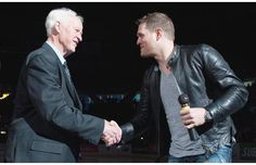 March 1, 2013 | Gordie Howe shakes hands with Michael Bublé before Bublé sings Happy Birthday at Howe's 85th birthday celebration. Both Gordie Howe and Michael Bublé are part owners of the WHL franchise, the Vancouver Giants. | photo by Gerry Kahrmann, PNG