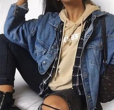 Jean jacket, plaid, and hoodie combo. Fall style