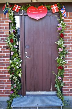 Danish wedding tradition - the bride's front door is decorated by family & friends on the morning of her wedding.