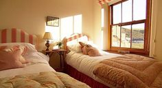 The mansion has views such as this from the twin bedroom of the rugged landscape and is ju...