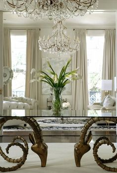 New Orleans New Elegance. Magnificent. Ram table!  Love the raised sitting areas with a chrome border. Luxurious furniture, draperies, wall  lovely