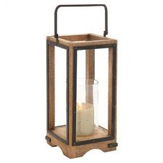 """Add artful appeal to your entryway console or living room etagere with this wood and iron candle lantern, showcasing a glass hurricane and open design.  Product: Candle lanternConstruction Material: Iron and mango woodColor: Black, brown and clearAccommodates: (1) Candle - not included Dimensions: 22"""" H x 8"""" W x 8"""" D"""