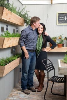 HGTV: The Fixer Upper hosts pose for a photo in the Ivy home's herb garden.