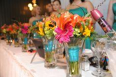 Bridesmaid bouquets as floral arrangements at head table