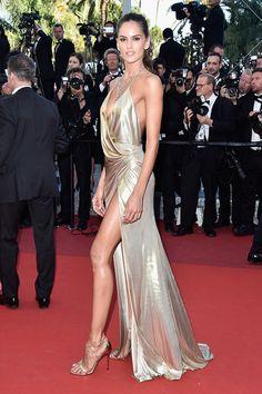 Izabel Goulart at Cannes 2016 wearing a golden slip dress - Supermodels still wear slip dress