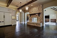 Adore this kitchen with fireplace