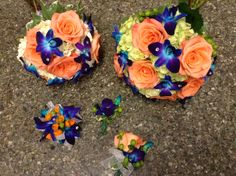 Orange roses, blue bomb orchids, and green hydrangea, bridal bouquets. Wedding Flower Packages, Wedding Flowers, Bridesmaid Bouquet, Bridal Bouquets, Groomsmen Boutonniere, Flower Packaging, Green Hydrangea, Wedding Planning, Wedding Ideas