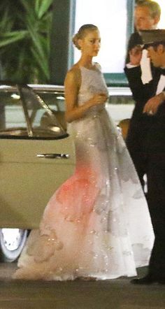 Beatrice Borromeo in Valentino couture Spring 2015 gown, is an incredible creation. Made from the most delicate white tulle, and hand embroidered with lovely clouds of silver lamé, this dress is couture in its most decadent form. Probably taking days to create, it makes Beatrice look a million dollars!