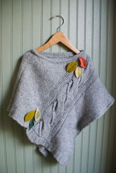 recycled sweater poncho--looks like sleeve opening becomes neck opening
