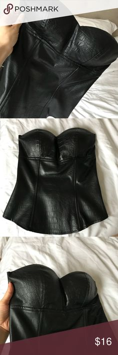 Black leather bustier top Strapless. Tight fitting. Back zipper that goes all the way to the bottom. Straps on the inside for hanging. Never worn. Super sexy on! Leather looking but not real. Tops Tank Tops