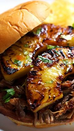 GRILLED PINEAPPLE PORK SANDWICHES ~ 2-1/2 lbs. pork shoulder or pork butt...2 cloves garlic, minced...1 red onion, diced...2 red bell peppers, diced...1-2 jalapenos, diced (keep the seeds for heat)...1 c. pineapple juice...8 King's Hawaiian sandwich buns....1 pineapple, peeled & cored...1/4 c. fresh cilantro or parsley for topping