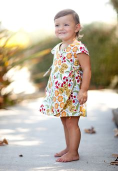 Girl's Dress Pattern. IRIS DRESS PDF Sewing Pattern & Tutorial. This adorable wrap dress is COMPLETELY reversible and has sweet little capped sleeves. No zippers or buttons needed. Ties on sides. Pattern pieces are included except for ties (rectangle measurements are given).