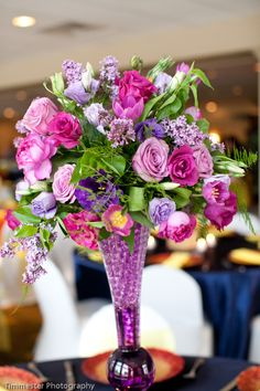 #centerpiece of purple and lavender   bergeronsflowers.com   timmesterphotography.com