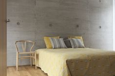 Lovely Doris yellow pattern as a bedspread. perfect match with concrete​ walls.