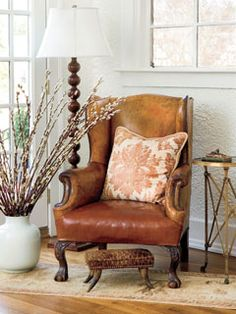 Create this sweet spot in a living room or entryway with a few key furniture pieces and a bundle of pussy willow branches.