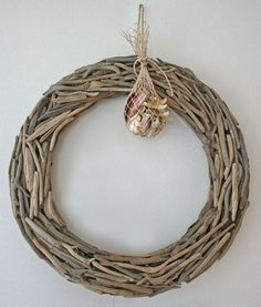 Driftwood Wreath  A wooden wreath gives you a beautiful, rustic coastal Christmas style. Individually handcrafted with natural driftwood and finished on both sides, each wreath comes with a bag...