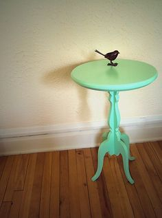 tiny green table and little black bird