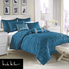 @Overstock - This elegant coverlet by Nicole Miller will add a designer feel to any bedroom. This coverlet features sleek stitched squares atop rich peacock blue matte satin.http://www.overstock.com/Bedding-Bath/Nicole-Miller-City-Square-Peacock-Full-Queen-size-Coverlet/6428159/product.html?CID=214117 $77.99