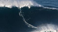 Hawaiian surfer, Garrett McNamara breaks wave-surfing record---78 foot wave off the coast of Portugal.