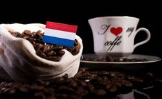 dutch flag in a bag with coffee beans isolated on black background