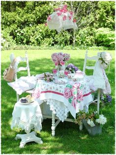 Use eclectic array of quilts, vintage tablecloths, and shalls for tablecovers