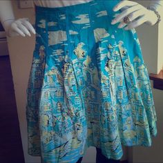 "Darling summer skirt! This darling skirt is reminiscent of the south of France!  It has a side zipper and has no elastic in the waist.  100% cotton, 23"" from waist to hem.  There is no size listed on the tag, but it fits a 35"" waist perfectly!!  8415 kenzie Skirts"