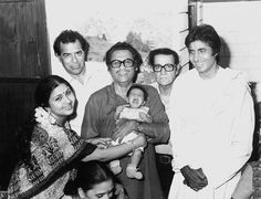 A nostalgic picture indeed: Amitabh Bachchan with Kishore Kumar who is holding his son Sumit, the singer's wife Leena Chandavarkar, late wrestler-actor Dara Singh and comedian Agha.