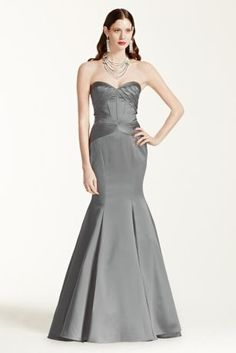 Breathtakingly romantic and exquisitely designed for a truly memorable night!   Strapless sweetheart dress features corset seam detailing and all over body contouring pleats for a stunning figure.  Fit and flare skirt elongates silhouette and adds just the right amount of drama.  Available in stores in Sangria and Marine. Sizes 0-14.  Fully lined. Center back zip imported polyester. Dry clean.