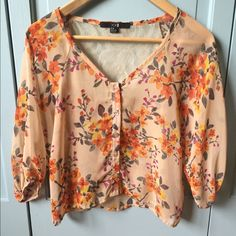 Forever 21 Cute top Very cute lantern sleeve blouse. Button up front. Lace on the back top part. One flaw which is a pulled thread on the right sleeve close to the underarm. Great with white pants, especially palazzo. Forever 21 Tops Blouses