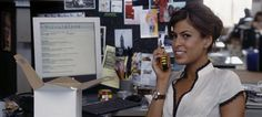 Hitch - Eva Mendez holding a portophone while there is a Rubik's cub on her desk.