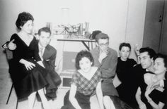 Beatnik gathering Manhattan in the early fifties; struggling, actors, musicians, writers - do you recognize the guy in the middle with the glasses?  Or the fella on the right with his arms around the girl?  You win the prize if you said - James Dean & Oscar winner, Martin Landau.  The girls kept to the style of the day with A-line skirts that flattered the leg.  Men wore jackets & ties.  Jimmy, no doubt, wearing borrowed overcoat.