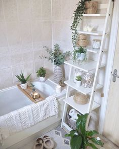 Bathroom redesign using accessories only. A makeover using clever storage such as baskets and houseplants can revamp your bathroom on a budget without the need for redecorating. Small bathroom design featuring ladder shelf and neutral home accessories Simple Bathroom, Bathroom Small, Cute Bathroom Ideas, Bathroom Vinyl, Small Bathroom Decorating, Boho Bathroom, Bathroom Flowers, Decoration For Bathroom, Small Bathrooms Decor