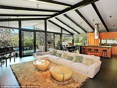 John Legend and Chrissy Teigen's spacious Hollywood Hills home includes an open living area and that kitchen that you've seen a hundred times on Chrissy's Instagram http://dailym.ai/12e3TH3