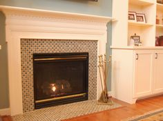 Fireplace Design...this colorful glass/stone mosaic tile replaced the  Builder Grade black granite.