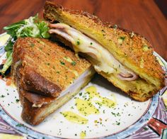 April 2015 French Toast of the Month at Miss Shirley's Cafe, Annapolis - Monte Cristo Stuffed French Toast; Filled with Smoked Ham, Smoked Turkey & Swiss Cheese, breaded in Panko & deep fried, drizzled with Honey Mustard Aioli, served with Mixed Greens