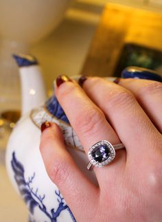 Hirsh mauve sapphire engagement ring, with a dark purple tinge to the stone. Set in white gold with diamonds surrounding. Proposal idea? Vintage tea party with antique blue and white china teapot. http://www.thejewelleryeditor.com/bridal/article/sapphire-engagement-rings-number-one-coloured-gem/ #wedding