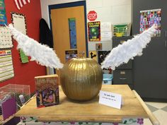 This year's fifth grade entry for the pumpkin decorating contest.  A Golden Snitch from the Harry Potter series.