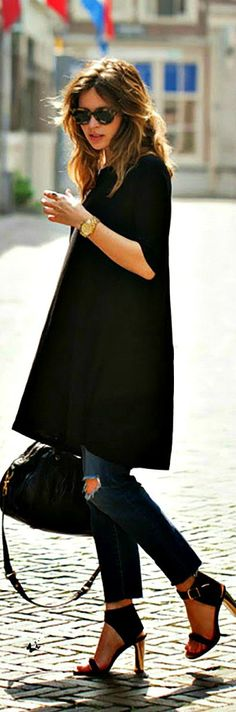 The little black dress in a tunic. Worn over jeans. Chic and hip