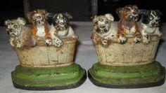ANTIQUE CAST IRON HUBLEY DOG IN BASKET