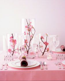 Quince branches enclosed in glass cylinders create a sculptural centerpiece that's grand but airy, so conversation can flow. Other flowering branches such as dogwood or forsythia would also do. Cut stems diagonally, and set in an inch of water.