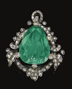 Emerald and diamond pendant, Late 19th Century. Set at the centre with a pear-shaped emerald, within a foliate border highlighted with rose diamonds, later pendant fitting.