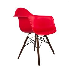 Some designs were ahead of their time. Considered the chair of tomorrow both for its design and its innovative single-mold manufacturing process, the Walnut Montmartre Arm Chair is inspired by one of t...  Find the Walnut Montmartre Arm Chair, as seen in the Mid-Century Madness Collection at http://dotandbo.com/collections/mid-century-madness?utm_source=pinterest&utm_medium=organic&db_sku=DBI0033-RED