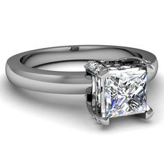 Classic Halo Ring With Princess Cut Solitaire Flanked With 4 Prong Pave Set Diamonds