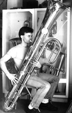 Contrabass ophicleide. The ophicleide is a keyed brass instrument similar to the tuba. It is a conical-bore keyed instrument belonging to the bugle family and has a similar shape to the sudrophone. The ophicleide was invented in 1817 and patented in 1821 by French instrument maker Jean Hilaire Asté (also known as Halary or Haleri) as an extension to the keyed bugle or Royal Kent bugle family. It was eventually succeeded by the tuba.