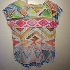 Tribal printed Shirt OFFERS ARE NEGOTIABLE! Colorful tribal printed shirt, had a water color effect. Would fit a small or medium. Tops Tees - Short Sleeve